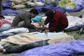 weeping-earthquake-victims.jpg