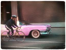 pink-cadillac-and-bicycle